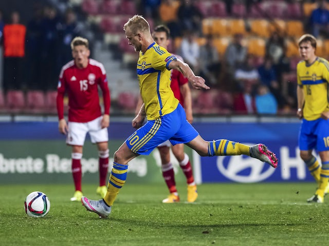 John Guidetti of Sweden scores a penalty during UEFA U21 European Championship semi final match between Denmark and Sweden at Generali Arena on June 27, 2015