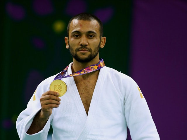 Gold medalist Kamal Khan-Magomedov of Russia poses on the medal podium following the Men's Judo -66kg Finals during day thirteen of the Baku 2015 European Games at the Heydar Aliyev Arena on June 25, 2015