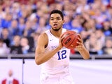 Karl-Anthony Towns #12 of the Kentucky Wildcats handles the ball in the second half against the Wisconsin Badgers during the NCAA Men's Final Four Semifinal at Lucas Oil Stadium on April 4, 2015