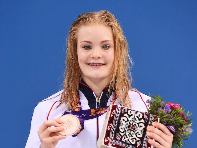 Team GB swimmer Layla Black poses with her bronze medal earned during the women's 200m breaststroke at the European Games on June 25, 2015