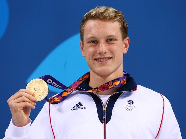 GB swimmer Luke Greenbank poses with his gold medal after winning the men's 100m backstroke at the European Games on June 24, 2015