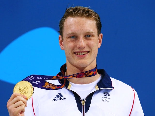Luke Greenbank poses with his gold medal after winning the men's 200m backstroke at the European Games on June 26, 2015