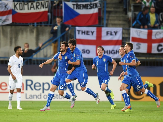 Marco Benassi of Italy celebrates with team mates after scoring to make it 2-0 as Nathan Redmond of England looks on during the UEFA Under21 European Championship match between England and Italy at Andruv Stadium on June 24, 2015