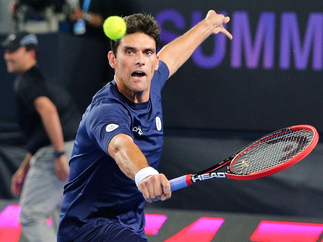 Mark Philippoussis of Australia hits a backhand in his match against Rafael Nadal of Spain during Rafa's Summer Set at Melbourne Park on January 14, 2015