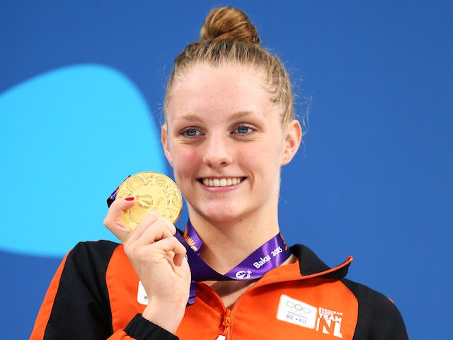 Gold medalist Marrit Steenbergen of the Netherlands celebrates during the medal ceremony for the Women's 100m Freestyle final during day twelve of the Baku 2015 European Games at the Baku Aquatics Centre on June 24, 2015