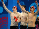 Martyn Walton, Daniel Speers and Duncan Scott celebrate as GB win gold in the men's 4x100m freestyle at the European Games on June 23, 2015