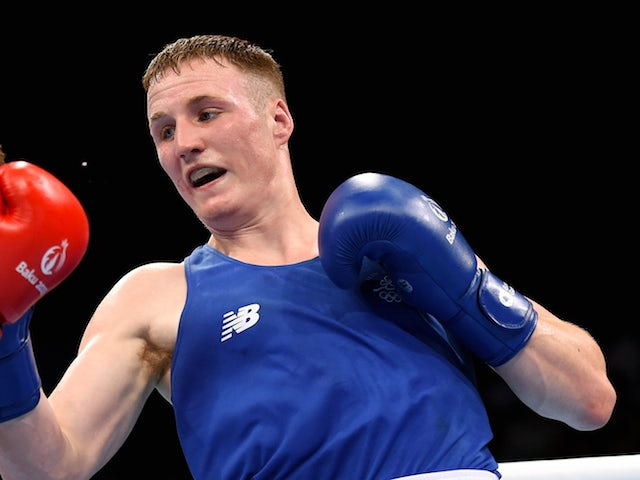 Michael O'Reilly of Ireland (blue) competes in the Men's Boxing Middleweight (75kg) Quarter Final during day twelve of the Baku 2015 European Games at the Crystal Hall on June 24, 2015