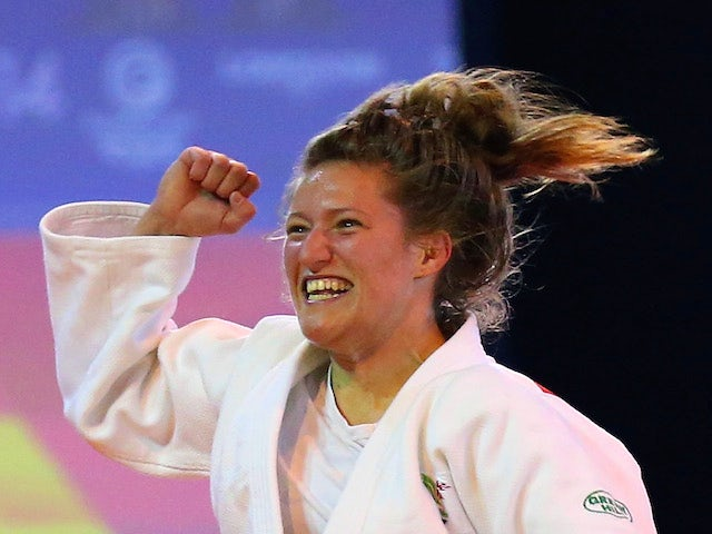 Natalie Powell of Wales celebrates victory over Gemma Gibbons of England in the Women's -78kg Judo gold medal final at the Scottish Exhibition and Conference Centre Precinct during day three of the Glasgow 2014 Commonwealth Games on July 26, 2014