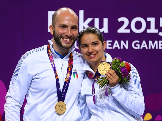 Gold medalists Niccolo Campriani and Petra Zublasing of Italy pose with the medals won during the Shooting Mixed Team 10m Air Rifle finals on day ten of the Baku 2015 European Games at the Baku Shooting Centre on June 22, 2015