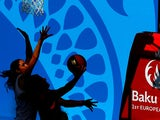 Orla O'Reilly of Ireland attempts to block a shot by Maria Aranzazu Gomez Novo of Spain in the Women's 3x3 Basketball preliminaries during day twelve of the Baku 2015 European Games at the Basketball Arena on June 24, 2015