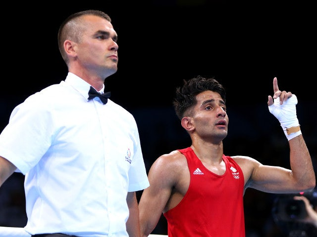 Team GB boxer Qais Ashfaq celebrates after beating Giorgi Gocatishvili of Georgia at the European Games on June 17, 2015