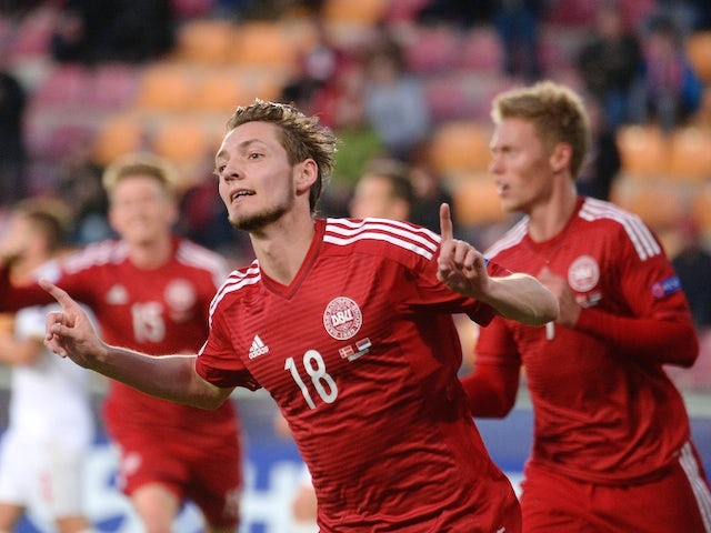 Denmark's Rasmus Falk celebrates after scoring during final tournament of the UEFA Under21 European Championship 2015 group A match between Denmark and Serbia on June 23, 2015