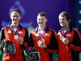Bronze medalists Mitch Delmas, Sjef Nan den Berg and Rick Van Der Ven of the Netherlands pose with the medals in the Men's Archery Team final during day six of the Baku 2015 European Games at Tofiq Bahramov Stadium on June 18, 2015
