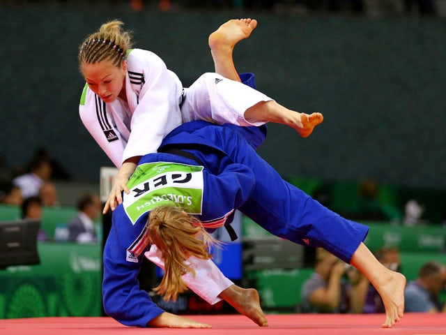 Sally Conway of Great Britain (white) and Szaundra Diedrich of Germany (blue) compete in the Women's Judo -70kg Quarter Final during day fourteen of the Baku 2015 European Games at the Heydar Aliyev Arena on June 26, 2015