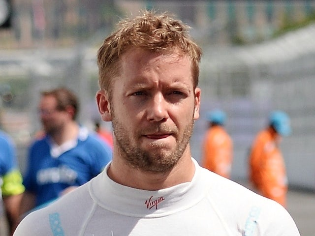 Virgin Racing Formula E driver Sam Bird of England walk in the pit lane after the qualifying session during the 2014 Forumula-E Putrajaya eprix race at the circuit in Putrajaya on November 22, 2014