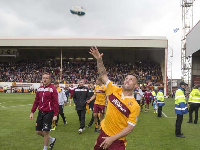Scott McDonald of Motherwell throws his shoes into the crowd during the Scottish Premiership play-off final 2nd leg between Motherwell and Rangers at Fir Park on May 31, 2015