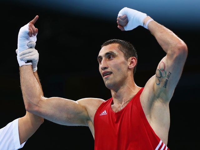 Teymur Mammadov of Azerbaijan celebrates victory over Peter Mullenberg of the Netherlands in the Men's Boxing Light Heavyweight (81kg) Quarter Final during day ten of the Baku 2015 European Games at the Crystal Hall on June 22, 2015