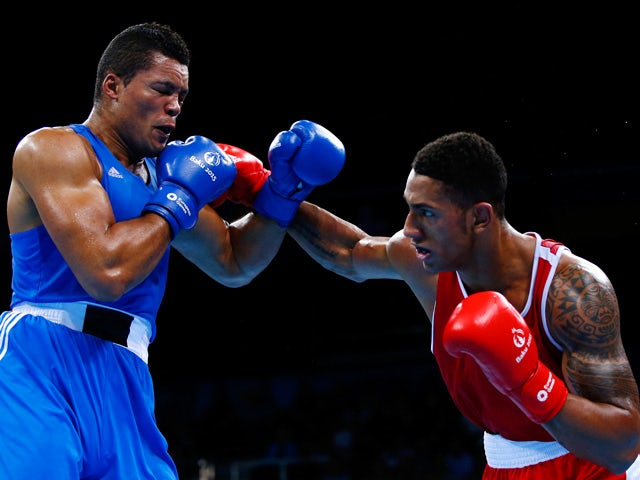 Tony Yoka of France (red) and Joe Joyce of Great Britian (blue) compete in the Men's Super Heavyweight +91kg semi final bout during day thirteen of the Baku 2015 European Games at the Crystal Hall on June 25, 2015
