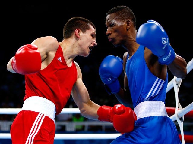 Viktor Petrov (red) of Ukraine and Collazo Sotomayor (blue) of Azerbaijan compete during the Men's Boxing Light Welter (64kg) semi final on day thirteen of the Baku 2015 European Games at the Crystal Hall on June 25, 2015