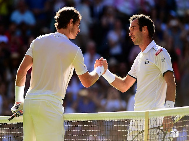 Andy Murray of Great Britain shakes hands with his opponent after winning his Gentlemen's Singles first round match against Mikhail Kukushkin of Kazakhstan during day two of the Wimbledon Lawn Tennis Championships at the All England Lawn Tennis and Croque