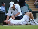 Andy Murray of Great Britain receives treatment to an injury in his Mens Singles Third Round match against Andreas Seppi during day six of the Wimbledon Lawn Tennis Championships at the All England Lawn Tennis and Croquet Club on July 4, 2015