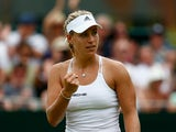 Angelique Kerber of Germany celebrates during her Women's Singles Second Round match against against Anastasia Pavlyuchenkova of Russia during day four of the Wimbledon Lawn Tennis Championships at the All England Lawn Tennis and Croquet Club on July 2, 2