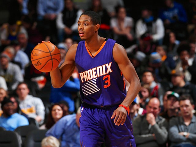 Brandon Knight #3 of the Phoenix Suns controls the ball against the Denver Nuggets at Pepsi Center on February 25, 2015