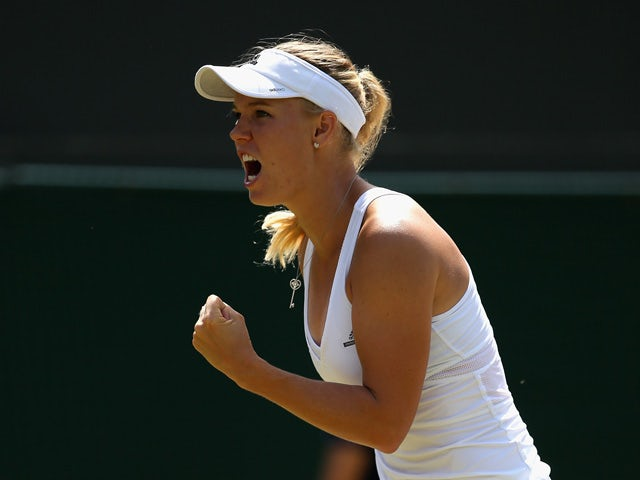 Caroline Wozniacki of Denmark reacts in her Ladies' Singles Third Round match against Camila Giorgi of Italy during day six of the Wimbledon Lawn Tennis Championships at the All England Lawn Tennis and Croquet Club on July 4, 2015