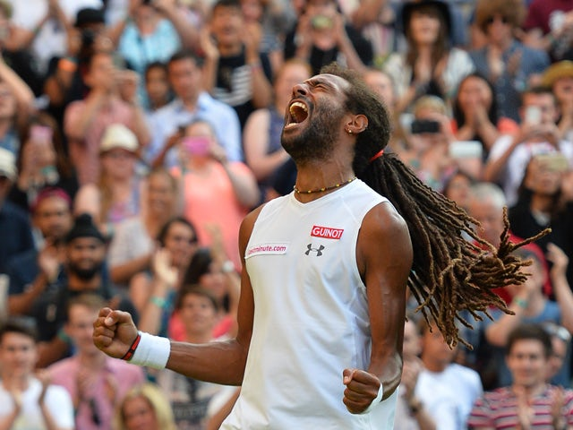 Germany's Dustin Brown celebrates beating Spain's Rafael Nadal during their men's singles second round match on day four of the 2015 Wimbledon Championships at The All England Tennis Club in Wimbledon, southwest London, on July 2, 2015