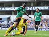 Schalke's Brazilian defender Felipe Santana (L) vies with Tottenham Hotspur's English striker Harry Kane (R) during the pre-season friendly football match between Tottenham Hotspur and Schalke at White Hart Lane, London, England on August 9, 2014