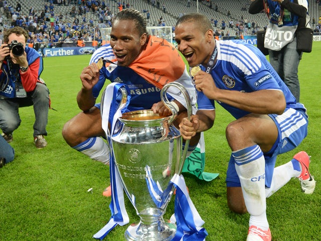 Chelsea's Ivorian forward Didier Drogba (L) and Chelsea's French midfielder Florent Malouda pose with the trophy after the UEFA Champions League final football match between FC Bayern Munchen and Chelsea FC on May 19, 2012