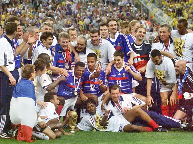 The French team celebrates with the FIFA trophy 12 July at the Stade de France in Saint-Denis, after France defeated Brazil 3-0 in the 1998 World Cup final