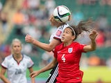 England's Fara Williams (C) and Germany's Melanie Behringer vie for the ball during the bronze medal match at the FIFA Women's World Cup in Edmonton, Alberta on July 4, 2015
