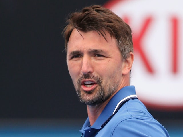 Goran Ivanisevic of Croatia in action in their legends doubles match during day nine of the 2015 Australian Open at Melbourne Park on January 27, 2015