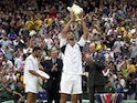 Goran Ivanisevic of Croatia lifts the Wimbledon trophy after beating Patrick Rafter of Australia during the Men's Final of The All England Lawn Tennis Championship at Wimbledon on July 9, 2001
