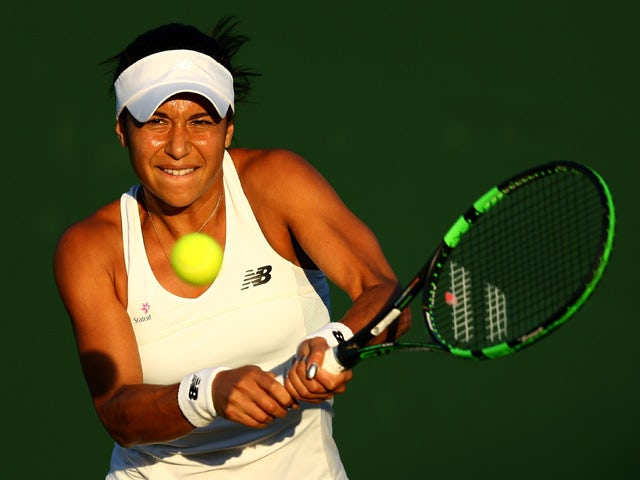 Heather Watson of Great Britain in action in her Ladies Singles first round match against Caroline Garcia of France during day one of the Wimbledon Lawn Tennis Championships at the All England Lawn Tennis and Croquet Club on June 29, 2015