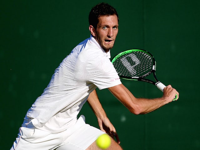 James Ward of Great Britain in Gentlemens Singles first round match against Luca Vanni of Italy during day two of Wimbledon on June 30, 2015