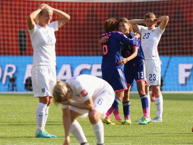 Mizuho Sakaguchi and Rumi Utsugi of Japan celebrate after the FIFA Women's World Cup Semi Final match between Japan and England at the Commonwealth Stadium on July 1, 2015