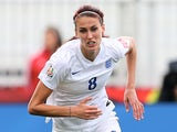 Jill Scott #8 of England takes the ball as Camille Abily #10 of France falls in the second half during the FIFA Women's World Cup 2015 Group F match at Moncton Stadium on June 9, 2015