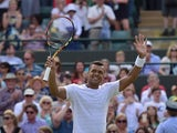 France's Jo-Wilfried Tsonga celebrates beating Spain's Albert Ramos-Vinolas during their men's singles second round match on day four of the 2015 Wimbledon Championships at The All England Tennis Club in Wimbledon, southwest London, on July 2, 2015
