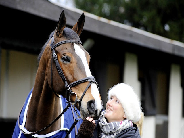 Three day eventer Laura Collett with ex racehorse Kauto Star at Kempton Park racecourse on December 26, 2013