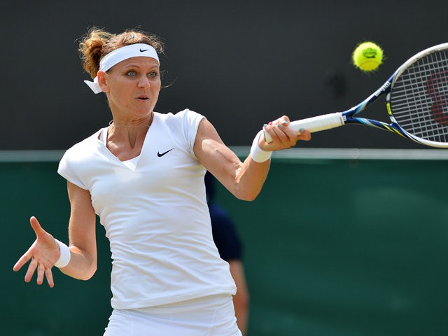 Czech Republic's Lucie Safarova returns to US player Sloane Stephens during their women's singles third round match on day five of the 2015 Wimbledon Championships at The All England Tennis Club in Wimbledon, southwest London, on July 3, 2015
