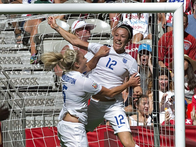 England defender Lucy Bronze (R) celebrates her goal against Canada with teammate Steph Houghton during a quarterfinal football match at the 2015 FIFA Women's World Cup at BC Place Stadium in Vancouver, British Columbia on June 27, 2015