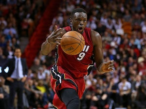 Luol Deng opts into Miami Heat deal