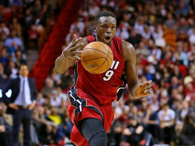Luol Deng #9 of the Miami Heat catches a pass during a game against the Chicago Bulls at American Airlines Arena on December 14, 2014