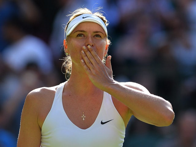 Russia's Maria Sharapova reacts after winning her women's singles first round match against Britain's Johanna Kontaduring on day one of the 2015 Wimbledon Championships at The All England Tennis Club in Wimbledon, southwest London, on June 29, 2015
