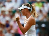 Maria Sharapova of Russia celebrates match point in her Ladies Singles Second Round match against Robin Haase of Netherlands during day three of the Wimbledon Lawn Tennis Championships at the All England Lawn Tennis and Croquet Club on July 1, 2015