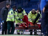 Murray Davidson of St Johnstone is stretchered off during the Scottish League Cup Quarter final between Rangers and St Johnstoneat Ibrox Stadium on October 28, 2014
