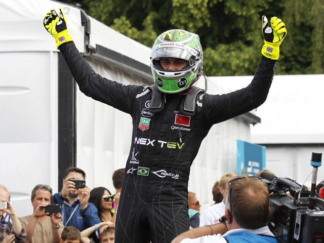 Nextev TCRs Brazilian driver Nelson Piquet JR celebrates at the end of the race after winning the inaugural World Championship title after the 2015 FIA Formula E London ePrix championship at Battersea Park in London, England, on June 28, 2015