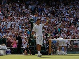 Serbia's Novak Djokovic celebrates after beating Australia's Bernard Tomic during their men's singles third round match on day five of the 2015 Wimbledon Championships at The All England Tennis Club in Wimbledon, southwest London, on July 3, 2015